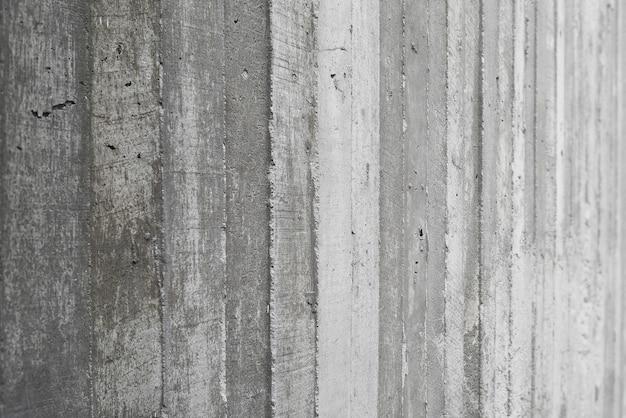 Tekstura drewniana formy praca stemplująca na surowej betonowej ścianie jako tło