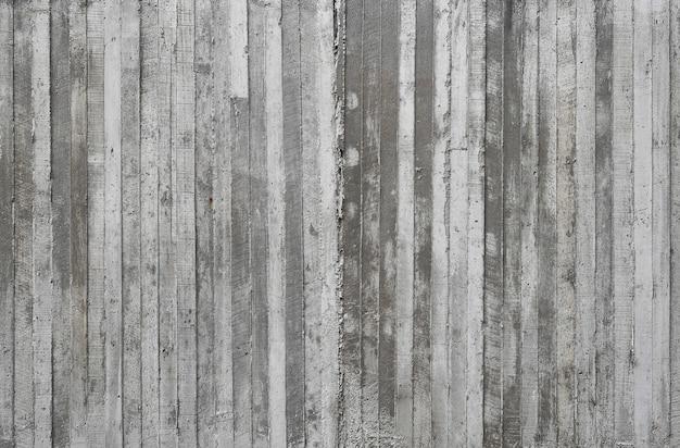 Tekstura Drewniany Szalunek Stemplujący Na Surowej Betonowej ścianie Jako Tło Premium Zdjęcia