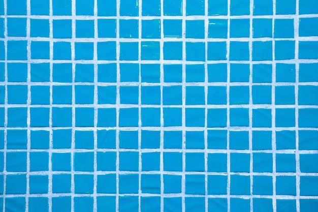 Tekstura drobnych małych płytek ceramicznych. niebieskie płytki podłogowe