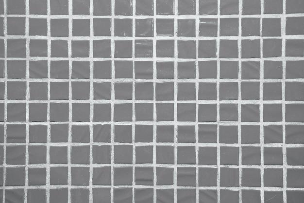 Tekstura drobnych małych płytek ceramicznych. szare płytki podłogowe