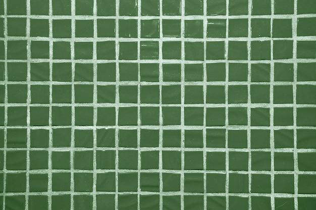 Tekstura drobnych małych płytek ceramicznych. zielone płytki podłogowe