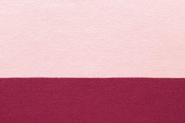 Tekstura dzianiny w kolorze różowym i marsala. miękka tkanina