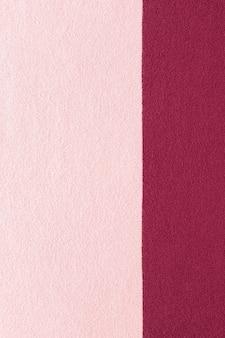 Tekstura dzianiny w kolorze różowym i marsala