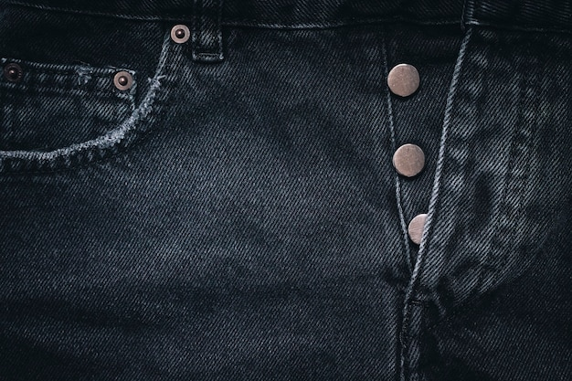 Tekstura dżinsów z kieszenią. bardzo szczegółowe zbliżenie czarnych dżinsów. fajne tło.