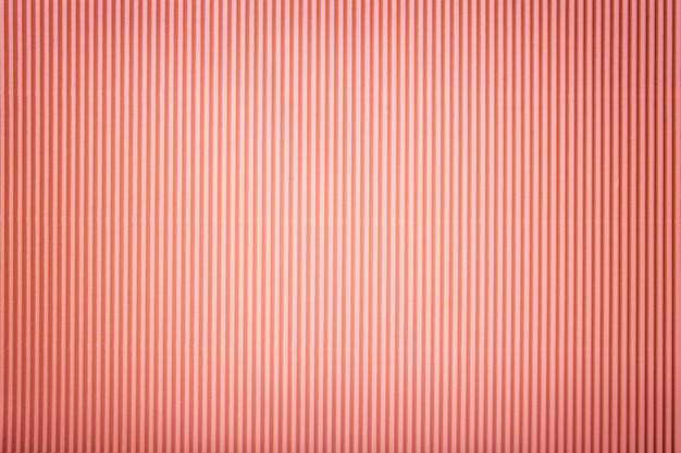 Tekstura falistego różowego papieru z winietą,