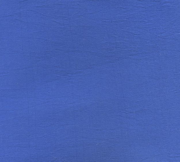 Tekstura gęstej niebieskiej tkaniny z cienkiej nici