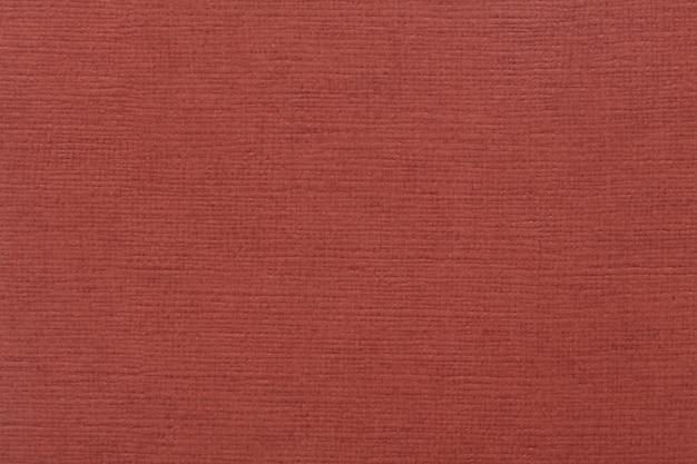 Tekstura gęstej tektury z aksamitną powłoką w kolorze winnym. wysokiej jakości tekstura w ekstremalnie wysokiej rozdzielczości