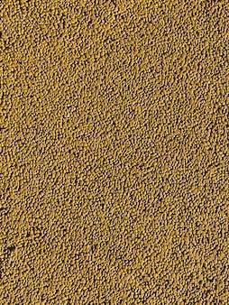 Tekstura gleby boiska sportowego pomalowana na żółto