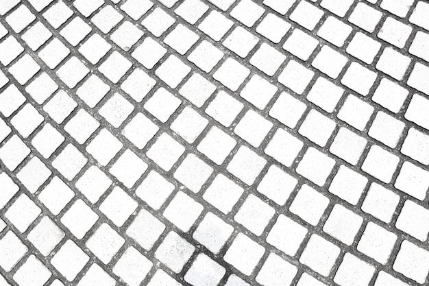 Tekstura kamiennego chodnika. granitowe brukowane tło chodnik.