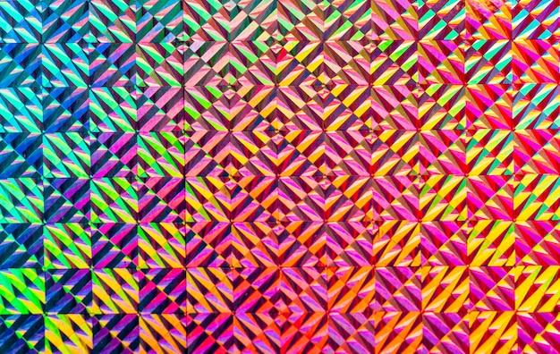 Tekstura kolorowej folii z efektem holograficznym. boże narodzenie, nowy rok, wakacje, festiwal, karnawał w tle