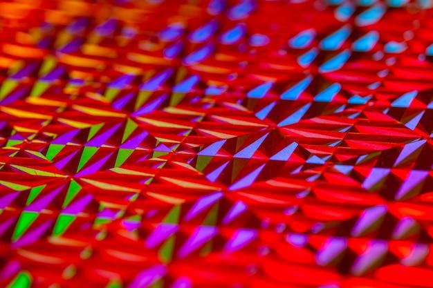 Tekstura kolorowej folii z efektem holograficznym świąteczny festiwal świąteczny i nowy rok