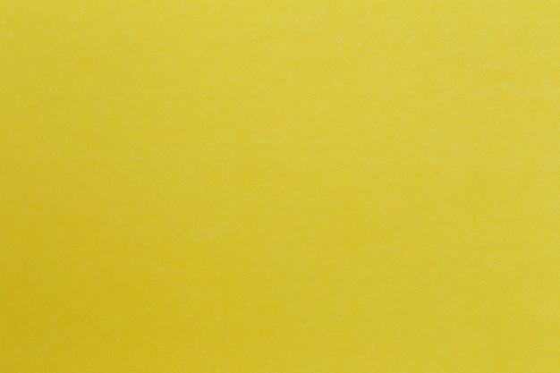 Tekstura koloru żółtego papieru sztuki kartonowy tło.