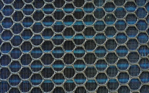 Tekstura łopatek wentylatora klimatyzatora z wymiennikiem ciepła. klimatyzator, wężownica kondensacyjna z ukośną siatką, żeberka do wymiany ciepła