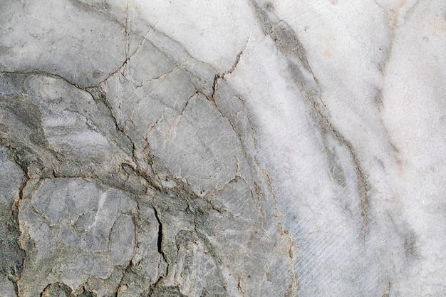 Tekstura lub tło marmur, kamień naturalny. z jasnymi i ciemnymi częściami.