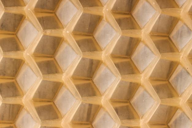Tekstura lub tło plaster miodu dla pszczół z bliska
