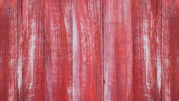 Tekstura malował starego drewnianego ściennego czerwonego tło