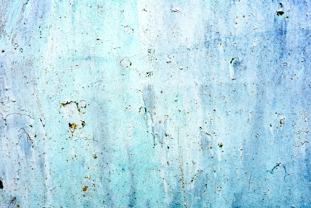 Tekstura metalowej ściany z pęknięciami i zadrapaniami