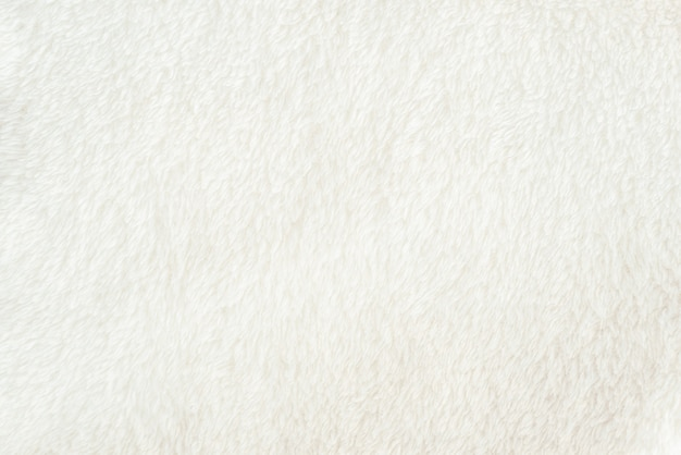Tekstura miękkiego białego materiału ze stosem, równomiernie rozłożona. delikatny tekstylny podkład dla twojego projektu.