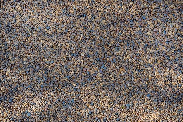 Tekstura migoczących otoczaków tło, kamienny bruk.