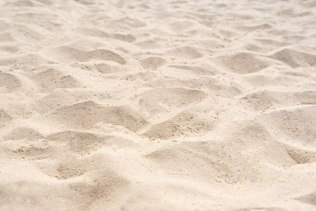 Tekstura natura piasek na plaży latem jako tło. przyroda plaża latem.