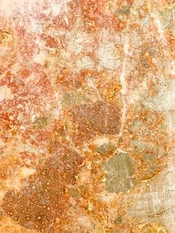 Tekstura naturalnego kamienia o różowym odcieniu.