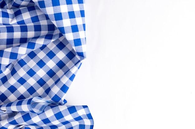 Tekstura niebieski obrus na białym tle