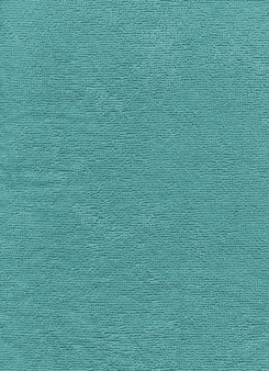 Tekstura niebieski ręcznik bawełniany z bliska tła.