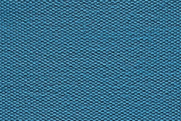 Tekstura niebieskiej tkaniny bawełnianej z bliska