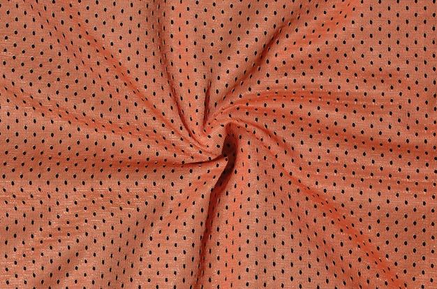 Tekstura odzieży sportowej z włókna poliestrowego. odzież wierzchnia do treningu sportowego ma strukturę siatki z rozciągliwej tkaniny nylonowej