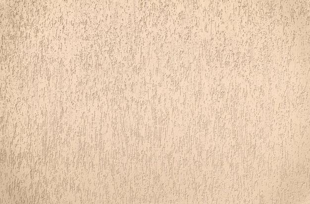 Tekstura otynkowanych ścian. dekoracyjne pokrycie ściany frontowej jest odporne na agresywne warunki zewnętrzne.