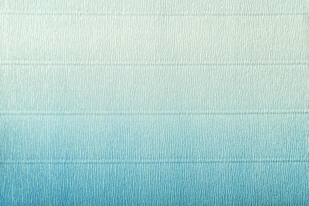 Tekstura papieru falistego jasnoniebieskiego i turkusowego z gradientem