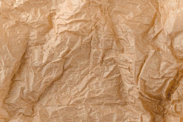 Tekstura papieru kraft. brązowy pomięty papier.