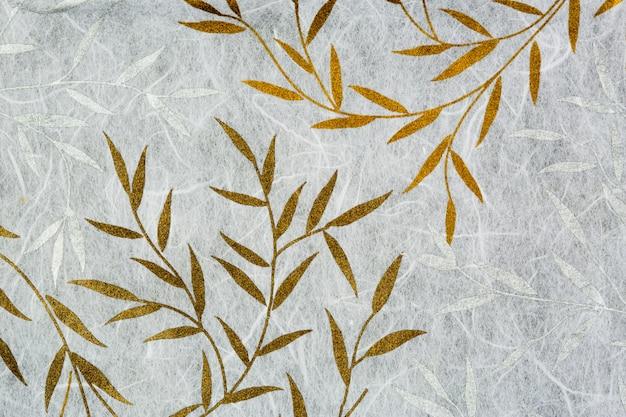 Tekstura papieru morwy ze złotym i srebrnym liściem