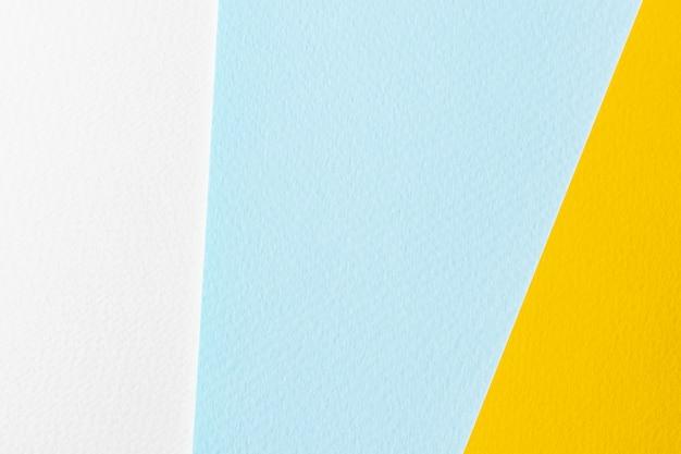 Tekstura papieru żółty, beżowy i niebieski. zdjęcie w tle