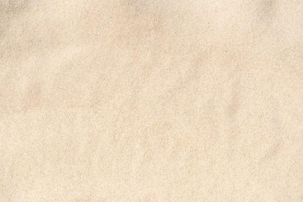 Tekstura piasku. brązowy piasek. tło z drobnego piasku. obraz zbliżenia.