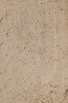 Tekstura piasku na plaży brzegu morza - styl retro, vintage.