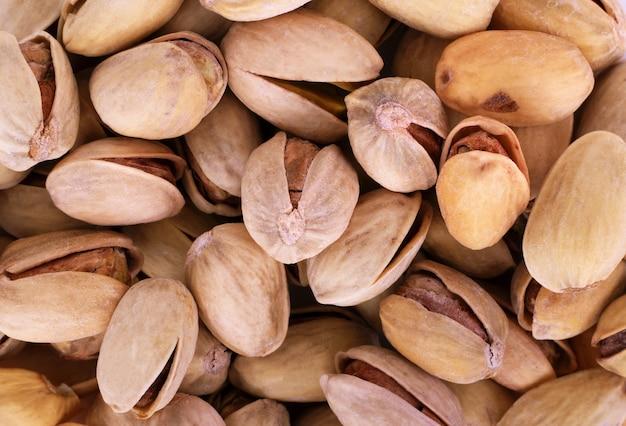 Tekstura pistacjowa. orzechy. zielone świeże pistacje jako tekstura
