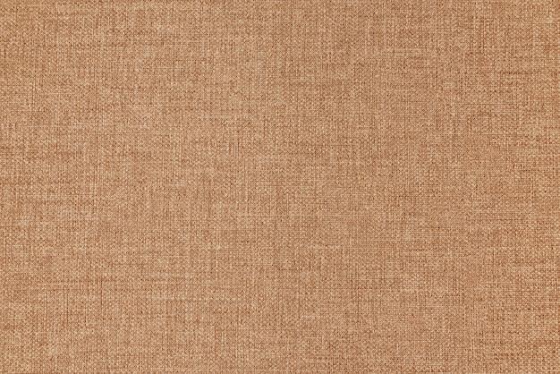 Tekstura płótna jako tło jasnobrązowe