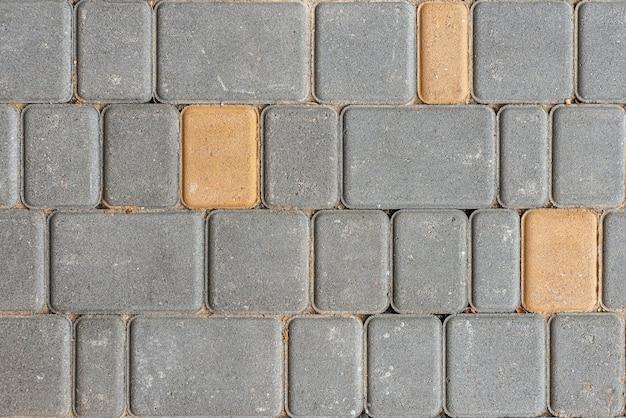 Tekstura płytki betonowe. tło chodnik miasta. płytki chodnikowe z kostki brukowej. widok z góry