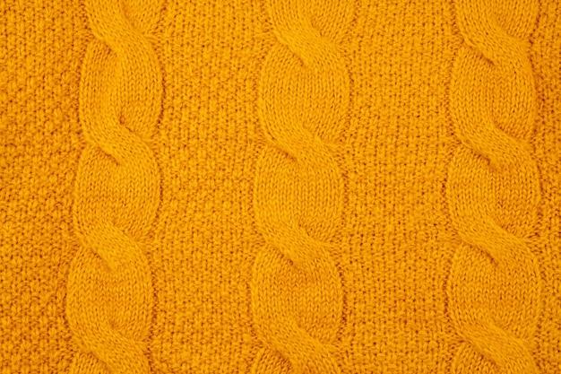 Tekstura pomarańczowy wełniany sweter z dzianiny