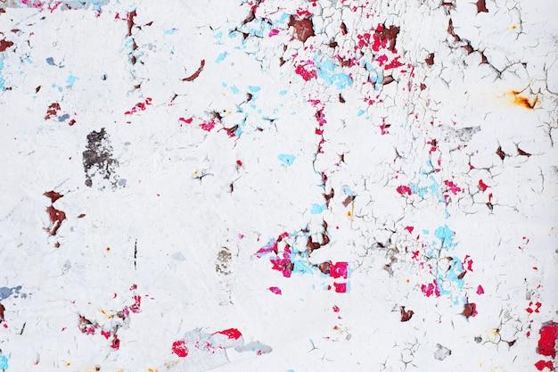 Tekstura rocznika ośniedziała szarości żelaza ściana z wiele warstwami farba i rdza