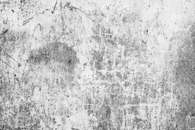 Tekstura, ściana, beton, może służyć jako tło. fragment ściany z rysami i pęknięciami