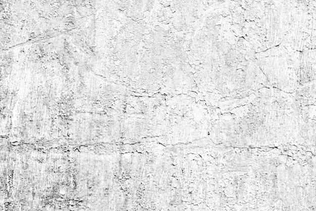 Tekstura, ściana, betonowe tło. fragment ściany z rysami i pęknięciami