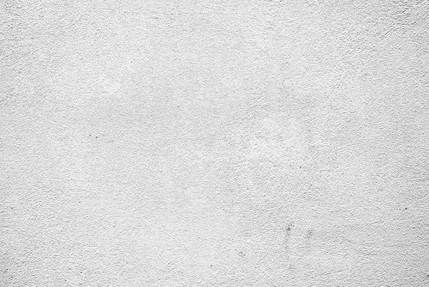 Tekstura, ściana, betonowy tło. fragment ściany z rysami i pęknięciami w tle