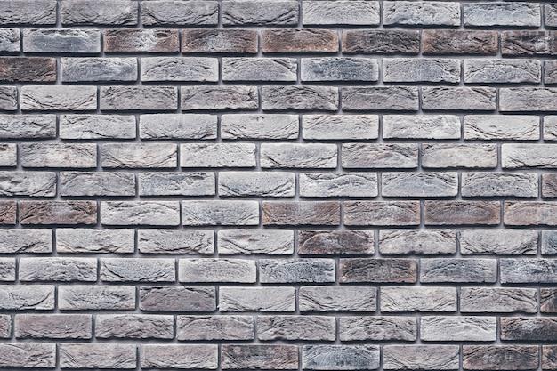 Tekstura ściana z cegieł brązowy. cegła szara grunge.