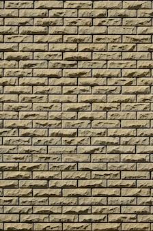 Tekstura ściana z cegieł od reliefowych kamieni pod jaskrawym światłem słonecznym