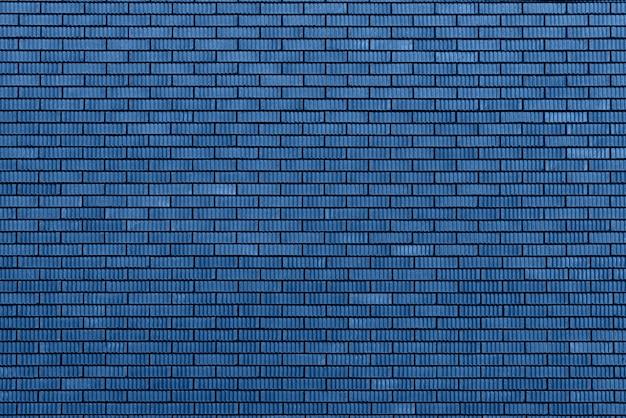 Tekstura ściana z cegieł. tło z kopii przestrzenią dla projekta. modny niebieski i spokojny kolor.