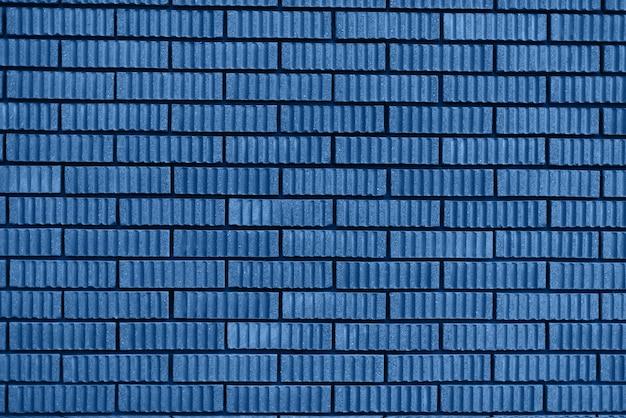Tekstura ściana z cegieł. tło z miejsca na kopię. modny niebieski i spokojny kolor.