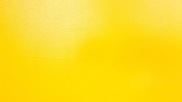 Tekstura ściany cementu żółty na tle