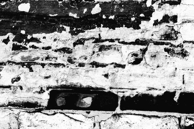 Tekstura ściany z cegły z pęknięciami i rysami, które można wykorzystać jako tło